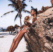 girl drinking coconut juice