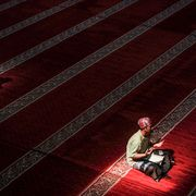 topshot   indonesian muslims read the koran at a mosque in bandung, west java, on may 23, 2018, during the month of ramadan   muslims throughout the world are marking the month of ramadan, the holiest month in the islamic calendar during which devotees fast from dawn till dusk photo by timur matahari  afp        photo credit should read timur matahariafp via getty images