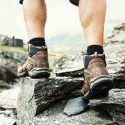 Footwear, Shoe, Leg, Hiking boot, Rock, Human leg, Adventure, Hiking equipment, Outdoor shoe, Recreation,