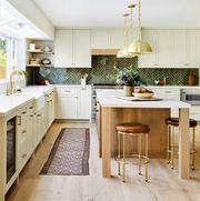 kitchen, cream cabinets, wooden kitchen island, green tiles, backsplash, leather brown stools