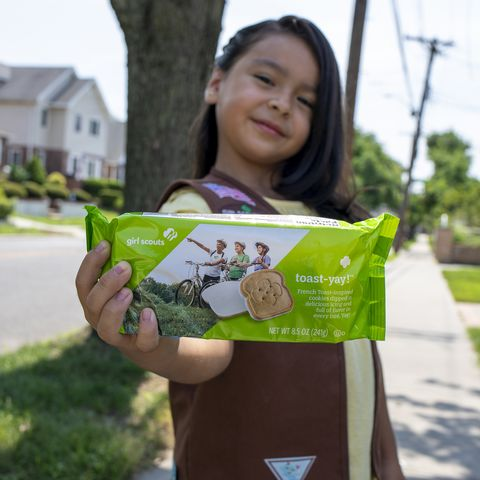 girl scout holding box of toast yay cookie