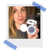 woman wearing makeupand holdingGLAMGLOW SUPERMATTIFY Clarifying Oil-Control Face Primer