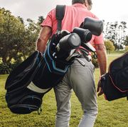 two men walking on course with golf bags
