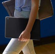 woman carrying google pixelbook go