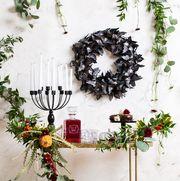 Christmas decoration, Wreath, Branch, Twig, Plant, Tree, Room, Floral design, Flower, Vascular plant,