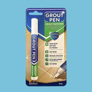grout pen with blue background