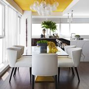 dining room, yellow ceiling, white chairs, plants, marble counter