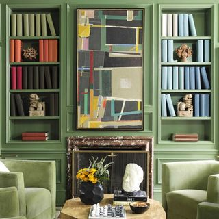 green library with a fireplace