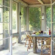screened in dining room for italian villa vibes