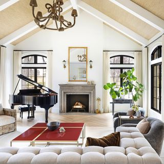 neutral living room with fireplace and piano