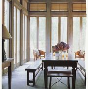 wooden dining table, wooden bench seats, candles