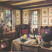 dining room, framed wall art, dining table set up with fine china and cutlery