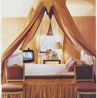 bedroom, canopy bed with gold curtains