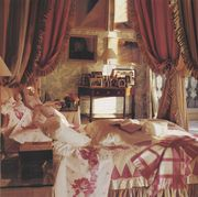 bedroom, canopy bed with red and gold curtains