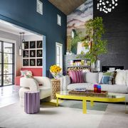 this artful entry by studiomunroe sets the stage fora vibrant living room