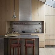wooden kitchen, wooden bar stools, ceiling lamp
