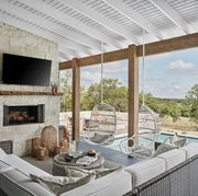 outdoor patio, wooden beams, outdoor tv, outdoor white and gray furniture, white hanging chairs