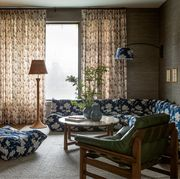 living room with blue floral sofa