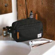 herschel dopp kit on sink with toiletries