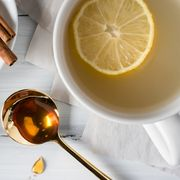 high angle view of honey with lemons on table