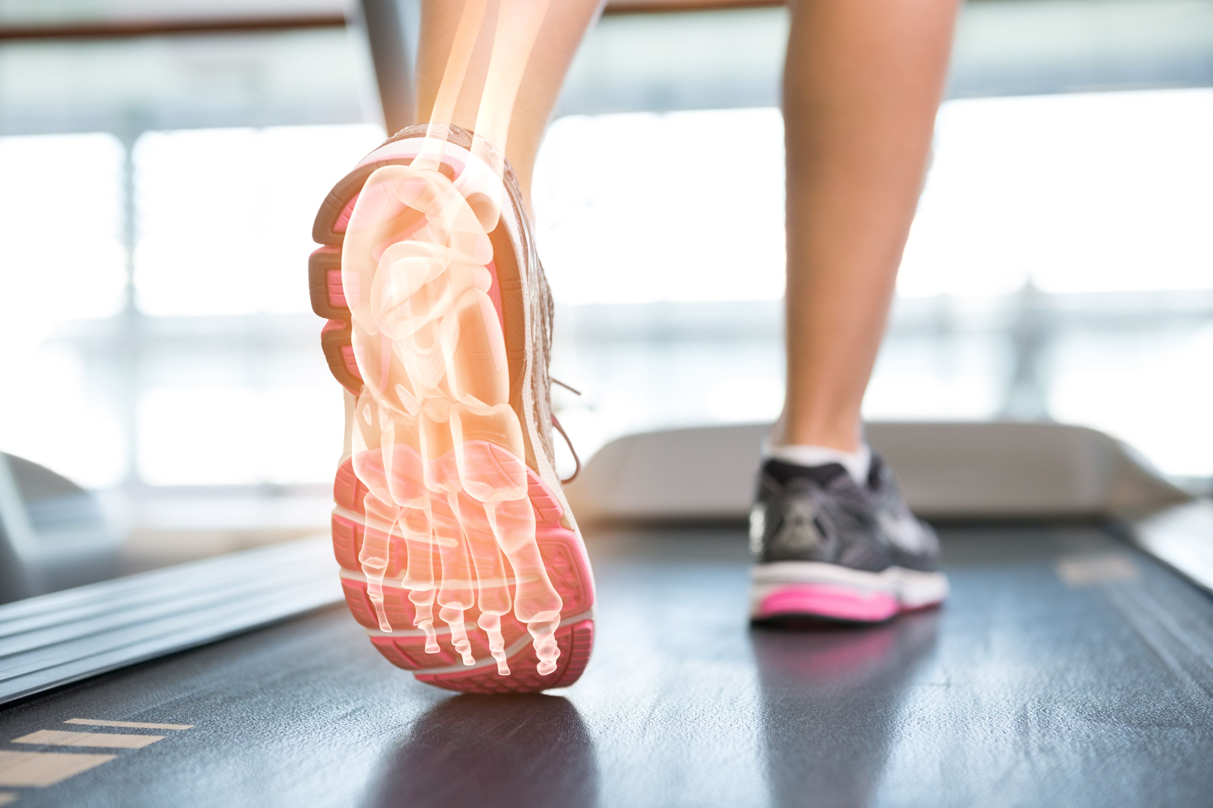 Highlighted foot of woman on treadmill