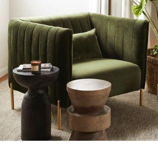 green velvet chair in living room