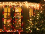 House window decorated with Christmas tree