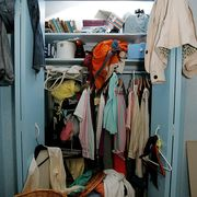 closet  110106  toronto, on 14 year old emma baumann daughter of vicky sanderson sits in front of her cluttered bedroom closet before the installation of a closet organizer november 1, 2006 tara waltontoronto star tlw photo by tara waltontoronto star via getty images