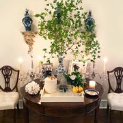 aerin lauder's bar table featuring pieces from her home decor line aerin