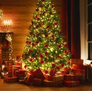 interior christmas magic glowing tree fireplace gifts in  dark