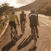 three road cyclists riding in a group