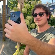 brandon holding iphone 13 mini