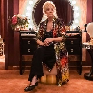 jean smart in a sparkly ombre robe and black slacks