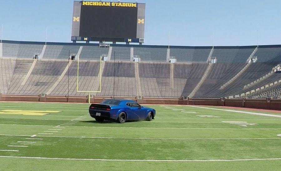 Jim Harbaugh Drives 840-HP Dodge Demon, Including on Michigan Stadium's Field [Video]