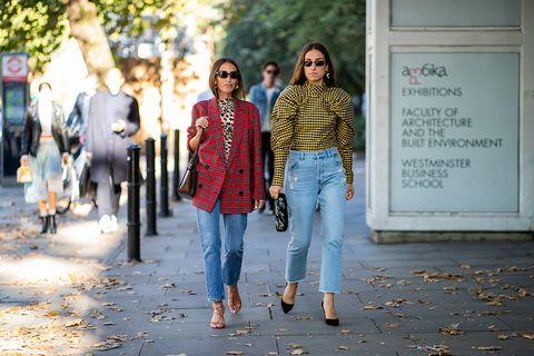 Jeans, People, Photograph, Denim, Street fashion, Yellow, Leaf, Fashion, Walking, Snapshot,