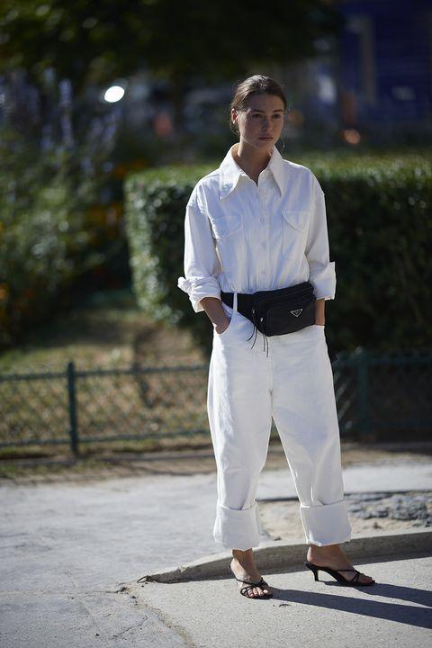 White, Dress shirt, Clothing, Street fashion, Standing, Jeans, Shirt, Fashion, Sleeve, Human,