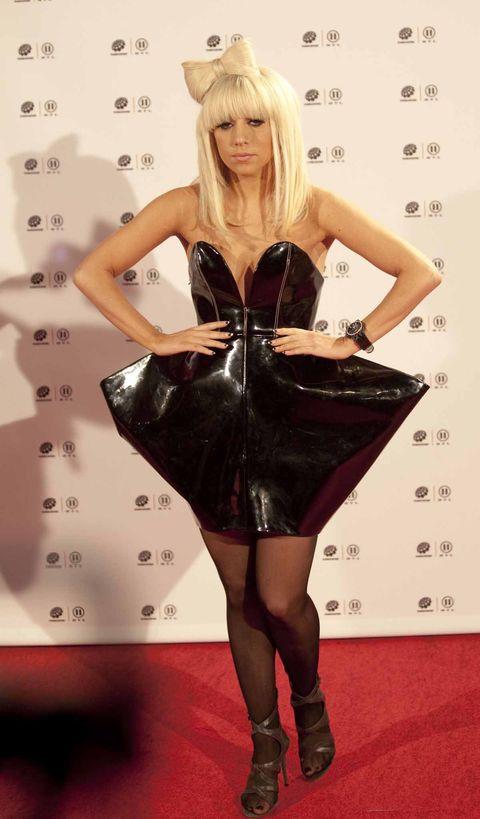 Clothing, Latex clothing, Dress, Blond, Leg, Carpet, Latex, Thigh, Cocktail dress, Little black dress,