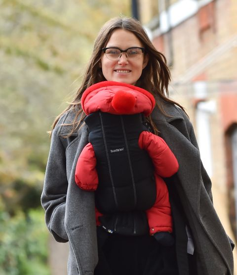 Red, Shoulder, Jacket, Outerwear, Joint, Fashion, Street fashion, Fun, Smile, Jeans,