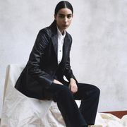 Suit, Formal wear, Clothing, Tuxedo, Sitting, Footwear, Fashion, Shoe, Outerwear, White-collar worker,