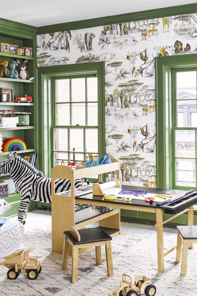 kids room with green paint and black and wood desk
