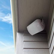 klipsch outdoor speaker hanging from outside of house