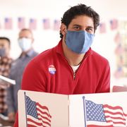 latin descent man votes in usa election wearing mask