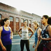 laughing group of women resting after run