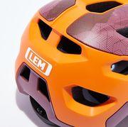 Helmet, Motorcycle helmet, Orange, Personal protective equipment, Clothing, Sports gear, Yellow, Bicycle helmet, Headgear, Sports equipment,