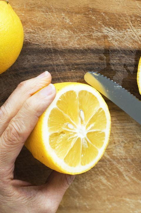 lemons on wood cutting board