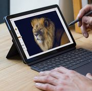 man drawing with pen on lenovo chromebook duet