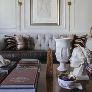 coffee table, coffee table books, white bust, leather couch