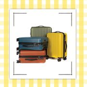 a set of colorful luggage and candles with inspirational quotes