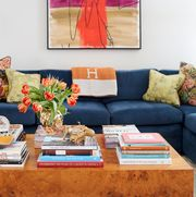 Living room, Furniture, Coffee table, Room, Orange, Table, Interior design, Couch, Red, Yellow,