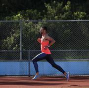 a male athlete runs on a track